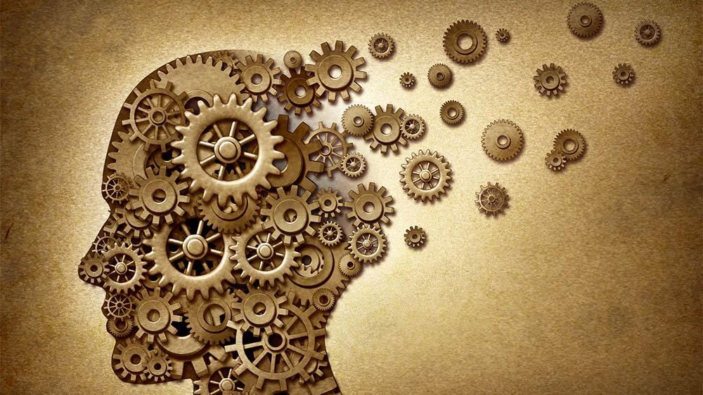 Ilustração de uma cabeça de perfil formada por engrenagens, com algumas engrenagens escapando da silhueta, representando a doença de Alzheimer.