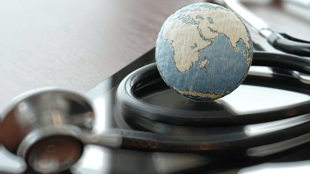 estetoscópio enrolado em globo terrestre. veja artigo sobre males do mundo